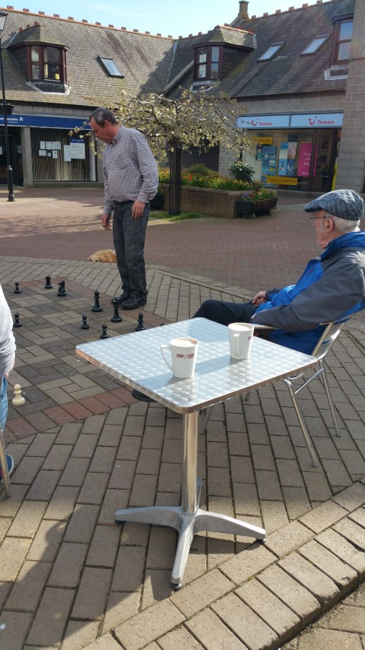 Chess & Coffee in the Square Courtesy of Symposium